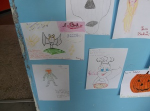 Drawings of Halloween costumes by the 8-10 year old class group.