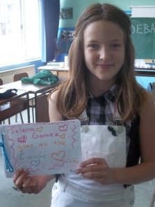 A member of the 8-10 year old class with her composition